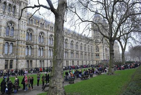Long queues form outside of the Natural History Museum, at the start of the school half-term holidays, in London February 21, 2011. REUTERS/Toby Melville