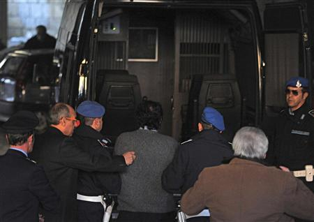 Captain Francesco Schettino (C) of cruise ship Costa Concordia is escorted back to a prison by police officers at Grosseto, after being questioned by magistrates January 17, 2012.  REUTERS/REUTERS/ANSA REUTERS/ANSA