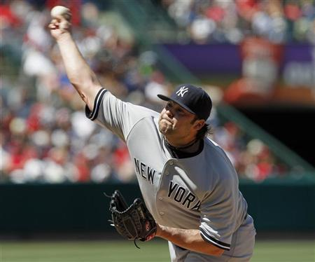 New York Yankees relief pitcher Joba Chamberlain (62) pitches against the Los Angeles Angels during the seventh inning of their MLB American League baseball game in Anaheim, California June 5, 2011.  REUTERS/Alex Gallardo