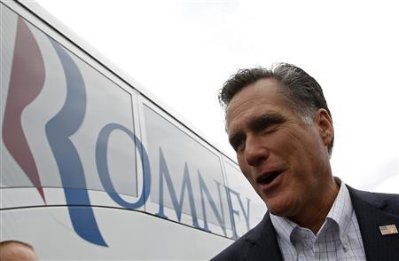 U.S. Republican presidential candidate and former Massachusetts Governor Mitt Romney walks to his campaign bus after a campaign stop in Florence, South Carolina, January 17, 2012. REUTERS/Jim Young