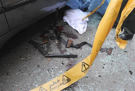 EDITORS' NOTE: Reuters and other foreign media are subject to Iranian restrictions on leaving the office to report, film or take pictures in Tehran.  Bloodstains are seen next to the car belonging to Iranian nuclear scientist Mostafa Ahmadi-Roshan at a blast site outside a university in northern Tehran January 11, 2012. Ahmadi-Roshan was killed by a bomb placed on his car by a motorcyclist in Tehran on Wednesday, and a city official blamed Israel for the attack, similar to attacks on nuclear scientists just over a year ago. REUTERS/IIPA/Sajad Safari