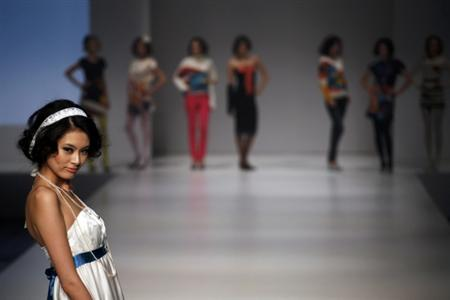 Models present creations by Hong Kong's designer Eliza Yeung as part of her Fall/Winter 2012 during Hong Kong Fashion Week January 18, 2012. REUTERS/Tyrone Siu
