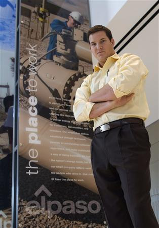 Daniel Rohling, a 28-year-old reservoir engineer, poses in the lobby of the El Paso building in downtown Houston December 15, 2011.  REUTERS/Richard J. Carson