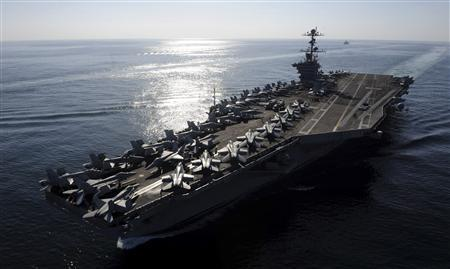 The aircraft carrier USS John C. Stennis transits the Straits of Hormuz in this U.S. Navy handout photo dated in this November 12, 2011 file photo. REUTERS/U.S. Navy/Mass Communication Specialist 3rd Class Kenneth Abbate/Handout/Files