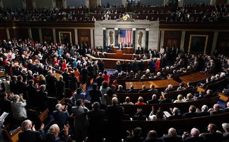 U.S. President Barack Obama receives a standing ovation as he addresses a Joint Session of Congress inside the chamber of the House of Representatives on Capitol Hill in Washington September 8, 2011. REUTERS/Larry Downing