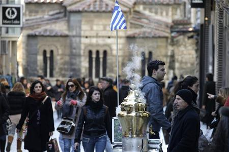 A man sells salepi beverage during the first day of the official sales season at a commercial street in Athens January 16, 2012. REUTERS/Yiorgos Karahalis