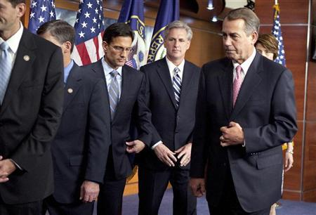 Speaker of the House John Boehner (R-OH) (R) walks with House Majority Whip Kevin McCarthy (R-CA) (2nd R) and Majority Leader Eric Cantor (R-VA) (C) after a media briefing on Capitol Hill in Washington, August 1, 2011. REUTERS/Joshua Roberts