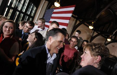 U.S. Republican presidential candidate and former Massachusetts Governor Mitt Romney greets supporters at a campaign rally at Winthrop University in Rock Hill, South Carolina January 18, 2012. REUTERS/Jim Young