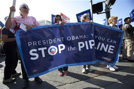 A group of demonstrators rally against the controversial Keystone XL oil pipeline outside President Barack Obama's fundraiser at the W Hotel in San Francisco, October 25, 2011.  REUTERS/Stephen Lam