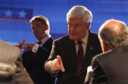 Republican presidential candidates Texas Governor Rick Perry (L) and former House Speaker Newt Gingrich speak to the moderators during a break in the Republican presidential candidates debate in Myrtle Beach, South Carolina, January 16, 2012. REUTERS/Jason Reed