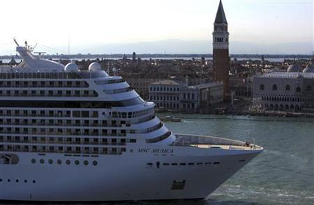 A cruise ship sails in the Venice lagoon close to Doge's Palace at St. Mark's Square in Venice, in this undated file photo.  REUTERS/Manuel Silvestri
