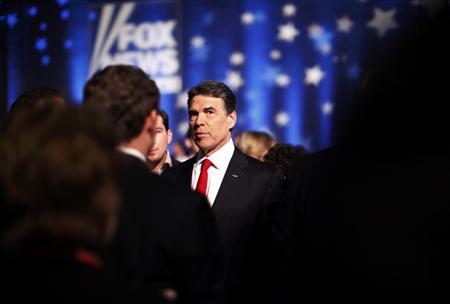 Rick Perry is seen backstage during a break in a Republican presidential candidates debate in Myrtle Beach, South Carolina, January 16, 2012. REUTERS/Jason Reed