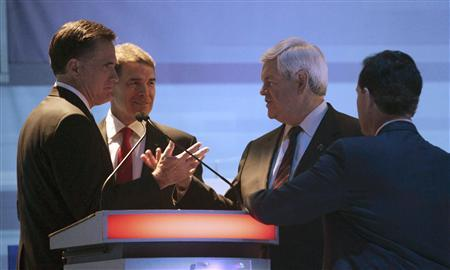 Republican presidential candidates (L-R) former Massachusetts Governor Mitt Romney, Texas Governor Rick Perry,  former House Speaker Newt Gingrich and former U.S. Senator Rick Santorum (R-PA) talk after a Republican presidential candidates debate in Myrtle Beach, South Carolina,  January 16, 2012. REUTERS/Charles Dharapak/Pool