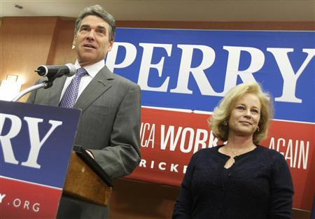 Texas Governor Rick Perry stands with his wife Anita as he announces he is dropping his run for the Republican presidential nomination during a news conference in Charleston, January 19, 2012. REUTERS/Chris Keane