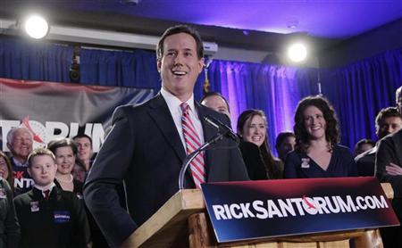 Republican presidential candidate and former U.S. Senator Rick Santorum pauses as he address his Iowa Caucus night rally in Johnston, Iowa, January 3, 2012. REUTERS/John Gress