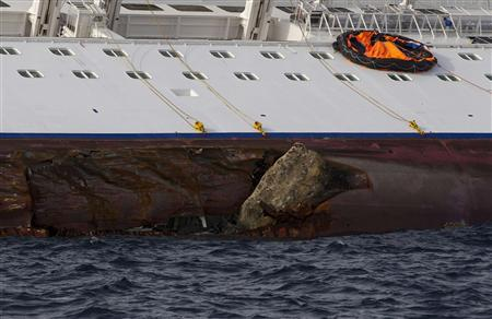 A breach is seen on the side of the Costa Concordia cruise ship after it ran aground off the west coast of Italy at Giglio island January 19, 2012. REUTERS/Paul Hanna