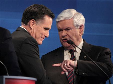 Republican presidential candidate former Massachusetts Governor Mitt Romney and former House Speaker Newt Gingrich (R) talk following the end of the Republican presidential candidates debate in Myrtle Beach, South Carolina, January 16, 2012. REUTERS/Charles Dharapak/POOL