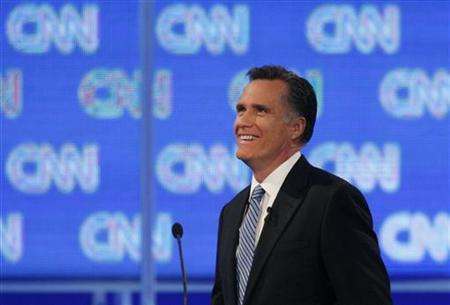 Republican presidential candidate former Massachusetts Governor Mitt Romney smiles as he participates in a Republican presidential candidates debate in Charleston, South Carolina, January 19, 2012. REUTERS/Jason Reed