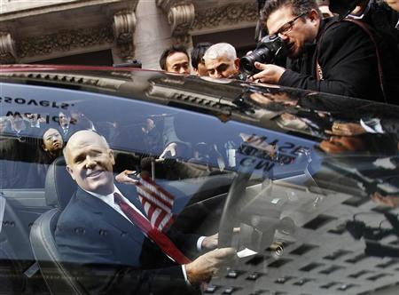 General Motors CEO Dan Akerson smiles while sitting in a GM auto outside of the New York Stock Exchange November 18, 2010.  REUTERS/Shannon Stapleton