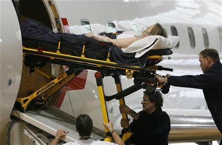 A patient is helped off a Canadair CL604 ''Challenger'' from the Swiss Air Ambaulance Rega during an evacuation simulation from Zurich to Geneva after Rega's annual news conference April 3, 2008. REUTERS/Christian Hartmann