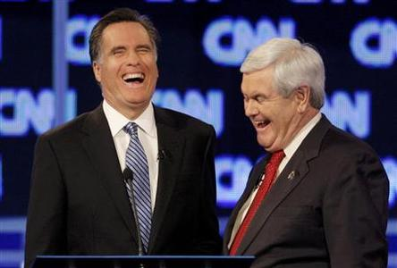 Mitt Romney and former House Speaker Newt Gingrich share a laugh during a break in the Republican presidential candidates debate in Charleston, South Carolina, January 19, 2012. REUTERS/Jason Reed