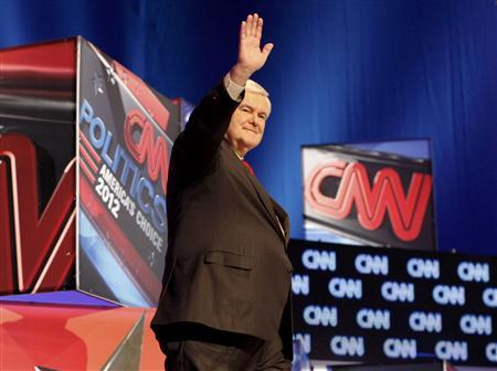 Republican presidential candidate former House Speaker Newt Gingrich waves as he arrives on stage to participate in a Republican presidential candidates debate in Charleston, South Carolina,  January 19, 2012.  REUTERS/Jason Reed