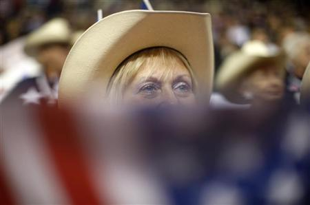 Texas delegate Sandy Golden watches the proceedings from behind a US flag  at the 2008 Republican National Convention in St. Paul, Minnesota September 4, 2008.   REUTERS/John Gress