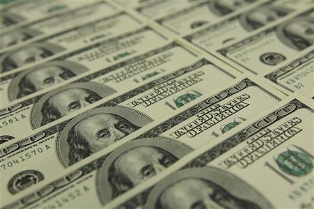 An illustration picture shows U.S. Dollar banknotes in OTP bank in Budapest, November 23, 2011.  REUTERS/Laszlo Balogh