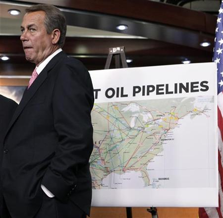 U.S. House Speaker John Boehner (R-OH) stands near a map of current oil pipelines in the U.S. during the GOP news conference about the Keystone XL pipeline decision on Capitol Hill in Washington January 18, 2012.  REUTERS/Yuri Gripas
