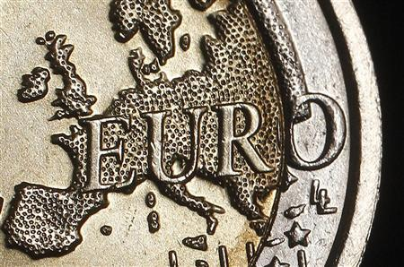 The map of Europe is featured on the face of a two Euro coin seen in this photo illustration taken in Rome, December 3, 2011.    REUTERS/Tony Gentile