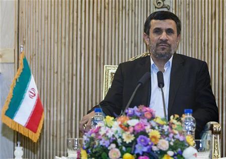 Iran's President Mahmoud Ahmadinejad speaks with journalists at Tehran's Mehrabad airport after his visit to Latin American countries January 14, 2012. REUTERS/Raheb Homavandi