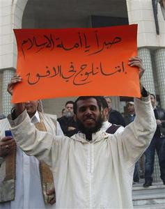 A Libyan Muslim supporting sharia law protests in Tripoli's Algeria Square January 20, 2012. The sign reads: ''Be patient, oh nation of Islam, we are on the horizon.'' REUTERS/Ismail Zitouny