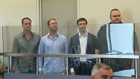 Megaupload founder Kim Dotcom (R) appears with other employees in Auckland's North Shore District Court after their arrest in this still image taken from a January 20, 2012 video. REUTERS/TVNZ via Reuters TV