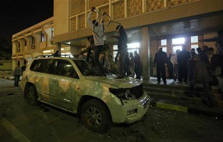 Libyans damage the car of National Transitional Council (NTC) Chairman Mustafa Abdel Jalil, to express their dissatisfaction towards the policy of the Council in governing the country, in Benghazi January 21, 2012. REUTERS/Esam Al-Fetori