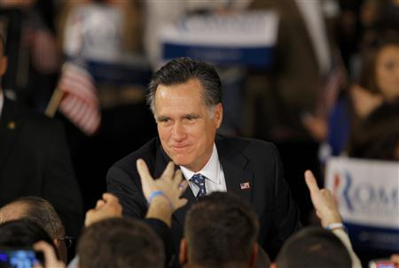 Republican U.S. presidential candidate and former Massachusetts Governor Mitt Romney shakes hands with supporters at his South Carolina primary election night rally in Columbia, South Carolina, January 21, 2012. REUTERS/Brian Snyder