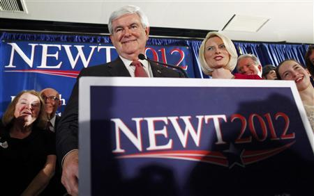 Republican U.S. presidential candidate and former U.S. House Speaker Newt Gingrich with his wife Callista (2nd R) and his granddaughter Maggie (R) at his side speaks at his South Carolina primary election night rally in Columbia, South Carolina, January 21, 2012. REUTERS/Eric Thayer