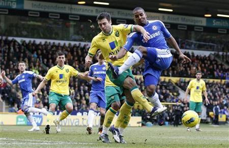 Norwich City's Russell Martin challenges Chelsea's Florent Malouda (R) during their English Premier League soccer match at Carrow Road in Norwich, eastern England, January 21, 2012. REUTERS/Darren Staples