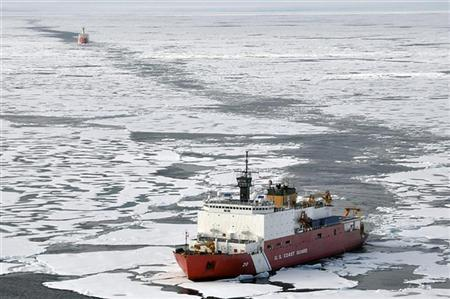 The Coast Guard Cutter Healy breaks ice ahead of the Canadian Coast Guard Ship Louis S. St-Laurent during an Arctic expedition, in this August 24, 2009 handout photo. REUTERS/U.S. Coast Guard/Patrick Kelley/Handout