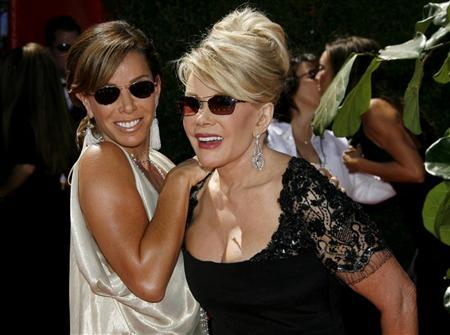 Actors Melissa Rivers (L) and Joan Rivers smile as they arrive for the 58th annual Primetime Emmy Awards at the Shrine Auditorium in Los Angeles August 27, 2006.     REUTERS/Fred Prouser