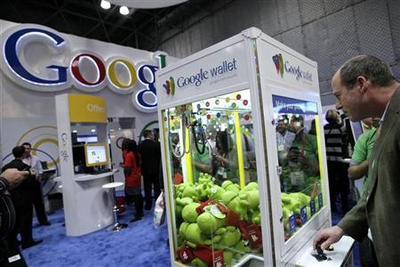 A man visits the Google stand at the National Retail Federation's Annual Convention and Expo in New York January 16, 2012. REUTERS/ Kena Betancur