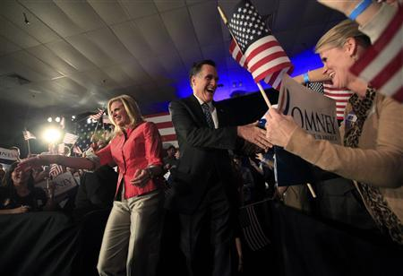 Republican U.S. presidential candidate and former Massachusetts Governor Mitt Romney shakes hands with supporters, as he arrives with his wife Ann (L) at his South Carolina primary election night rally in Columbia, South Carolina, January 21, 2012. REUTERS/Jim Young