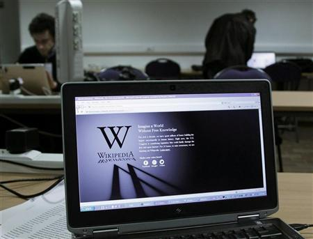 A reporter's laptop shows the Wikipedia blacked out opening page in Brussels January 18, 2012. REUTERS/Yves Herman