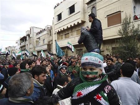 Demonstrators take part in a protest against Syria's President Bashar al-Assad in Baba Amro, near Homs, in this handout picture received January 22, 2012. REUTERS/Handout