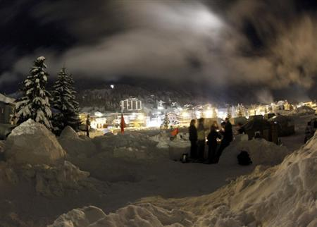 Members of the Occupy WEF movement gather at their camp site in the Swiss mountain resort of Davos January 22, 2012. REUTERS/Arnd Wiegmann