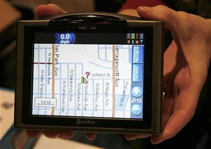 The Cobra Nav One 5000 portable mobile navigation system is displayed at the Consumer Electronics Show (CES) Unveiled event in Las Vegas, Nevada January 5, 2008. REUTERS-Rick Wilking