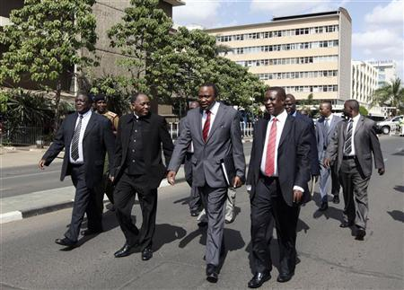 Kenya's Finance Minister Uhuru Kenyatta (2nd L) walks with other finance officials to Parliament building from his office in Kenya's capital Nairobi June 8, 2011. REUTERS/Noor Khamis