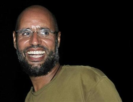 Saif al-Islam, the son of Libyan leader Muammar Gaddafi, smiles as he greets supporters in Tripoli in this August 23, 2011 file photo. REUTERS/Paul Hackett/Files