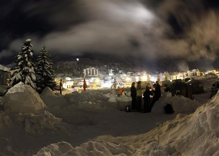 Members of the Occupy WEF movement gather at their camp site in the Swiss mountain resort of Davos January 22, 2012. The Occupy WEF members will stay in a camp of several igloos and tents to protest during the World Economic Forum (WEF), which takes place from January 25 to 29. REUTERS/Arnd Wiegmann