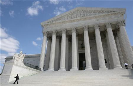Security guards walk the steps of the Supreme Court in Washington, October 1, 2010. REUTERS/Larry Downing
