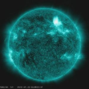 The Solar Dynamics Observatory captures an M8.7 class flare in a handout photo released by NASA January 23, 2012. The flare is shown here in teal as that is the color typically used to show light in the 131 Angstrom wavelength, a wavelength in which it is easy to view solar flares. The flare began at 10:38 PM ET on January 22, 2012, peaked at 10:59 PM and ended at 11:34 PM. REUTERS/NASA/SDO/AIA/Handout